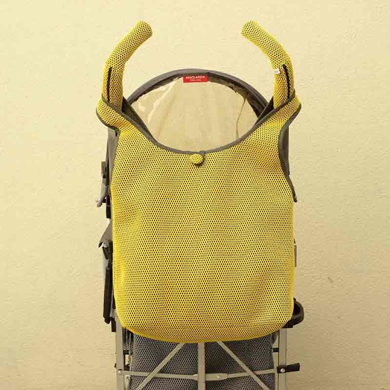 Bolso Camiseta amarillo para silla de paseo tipo Maclaren confeccionado en tejido transpirable
