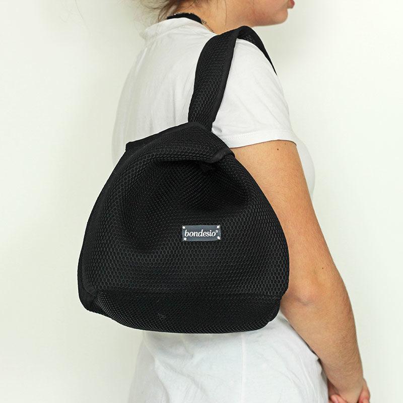 bolso negro transpirable