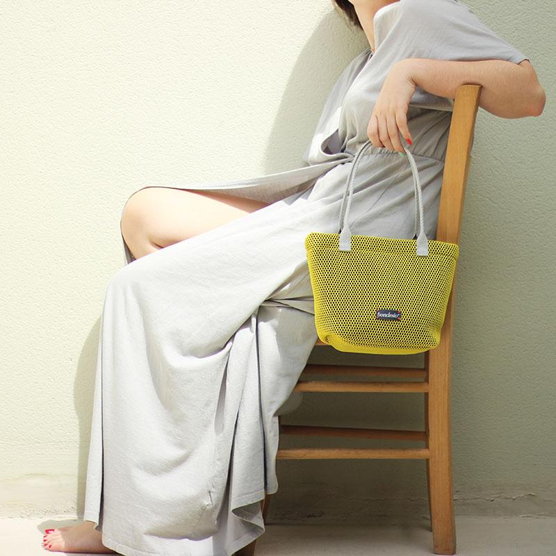 bolso amarillo lavable